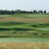 A view of a green protected by by a collection of sand traps at Neshanic Valley Golf Club