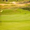 A green view from Running Deer Golf Club